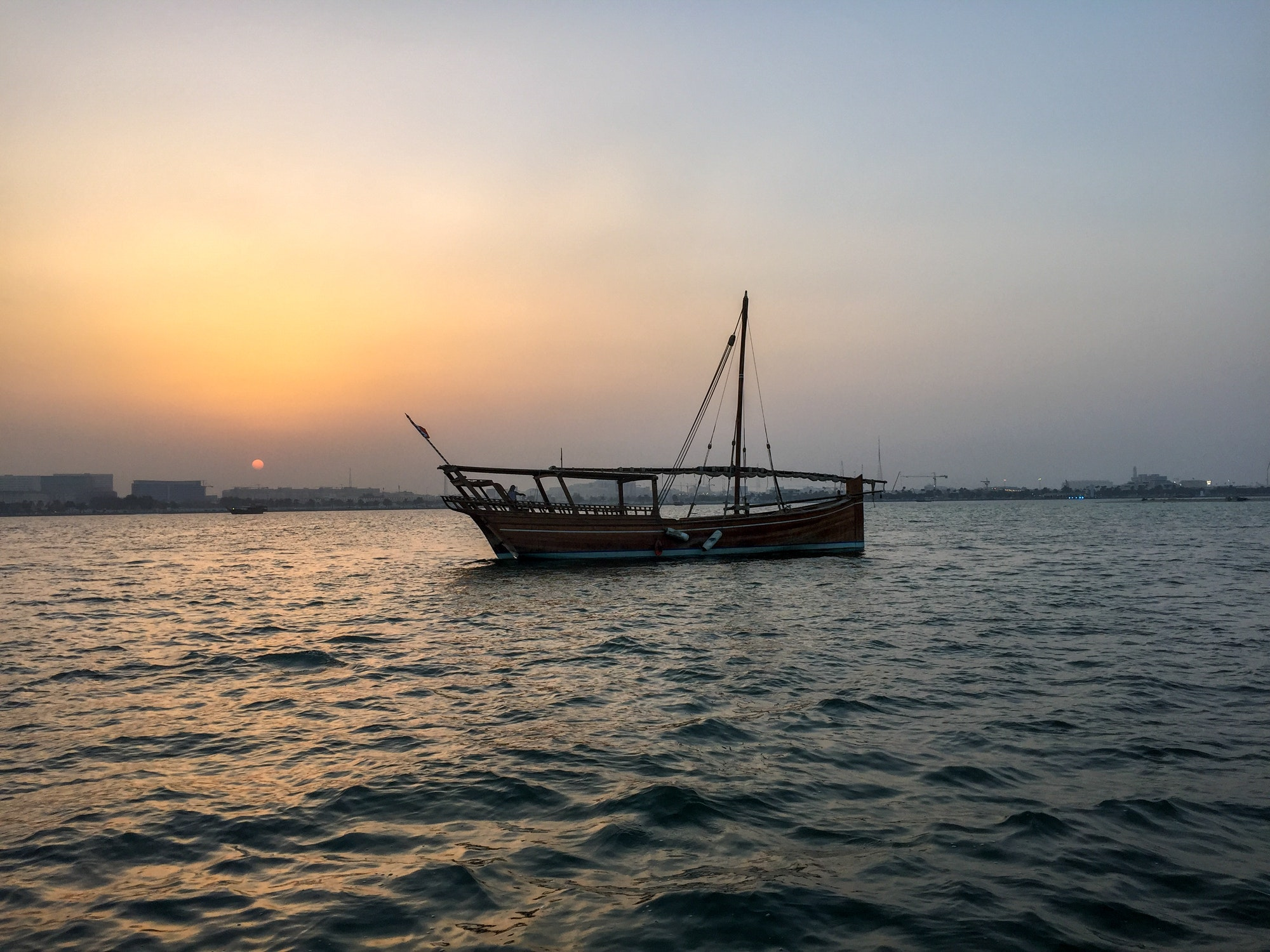 Traditional Dhow at sea of Qatar. Sea. Ocean. Travel. Traveling. Golden hour